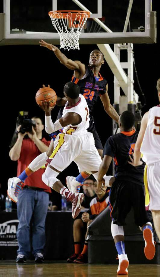 Rainier Beach's Djuan Piper (24) goes up to block a shot by Lakeside's Tramaine Isabell (2) in the first half of the Division 3A boys high school basketball championship game, Saturday, March 2, 2013, in Tacoma, Wash. Photo: Ted S. Warren / Associated Press
