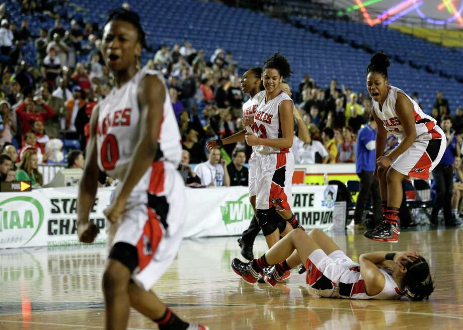 Cleveland players, including Asiyah Davis, right, and Alexia Mefi, second from right, celebrate at the buzzer after their 45-43 win over Seattle Prep in overtime of the division 3A girls high school basketball championship on Saturday, March 2, 2013, in Tacoma, Wash. Photo: Ted S. Warren / Associated Press