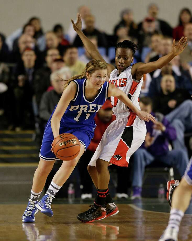 Seattle Prep's Nicole Hall, left, drives around Cleveland's Myzhanique Ladd, right, in the first half of the division 3A girls high school basketball championship, Saturday, March 2, 2013, in Tacoma. Photo: Ted S. Warren / Associated Press