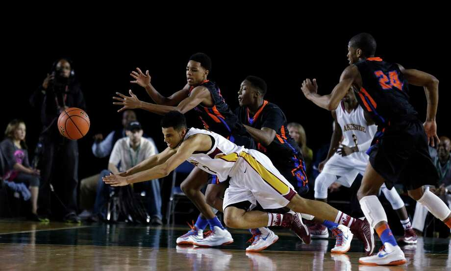 Lakeside's D'Marques Tyson, lower left, and Rainier Beach's Dejounte Murry, upper left, dive for a loose ball in the second half of the division 3A boys high school basketball championship on Saturday, March 2, 2013, in Tacoma, Wash. Rainier Beach defeated Lakeside 62-59 in overtime. Photo: Ted S. Warren / Associated Press