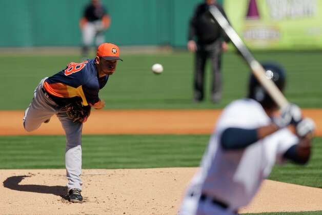 Tigers 8, Astros 5Astros pitcher Jarred Cosart, left, throws to the Tigers' Torii Hunter, right, during the first inning. Photo: David J. Phillip