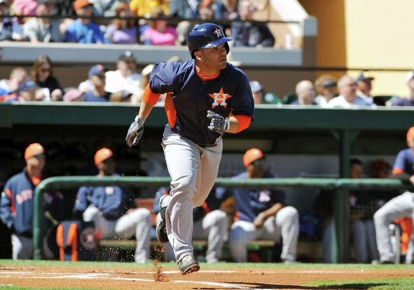 Jose Altuve runs to first base.