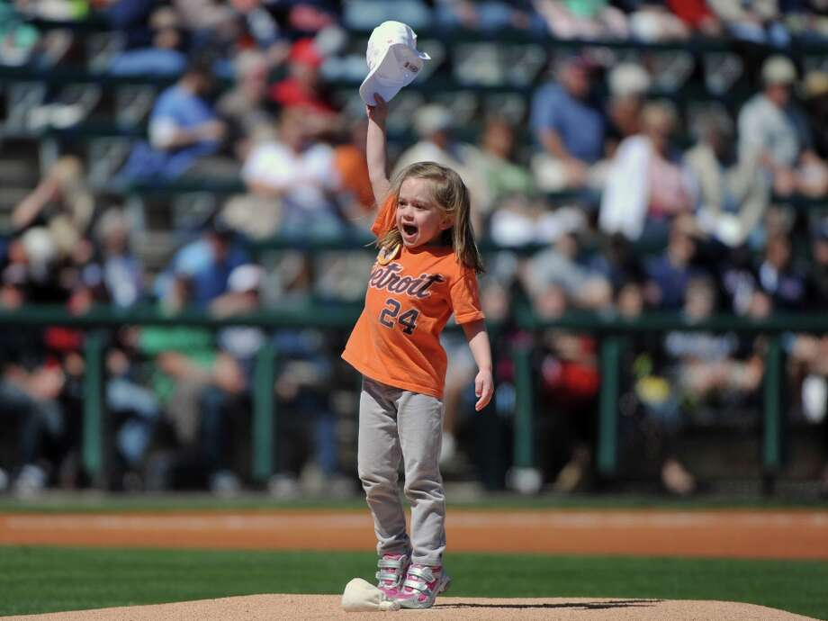A young fan celebrates after running the rosin bag to the mound before the game. Photo: Al Messerschmidt / 2013 Getty Images