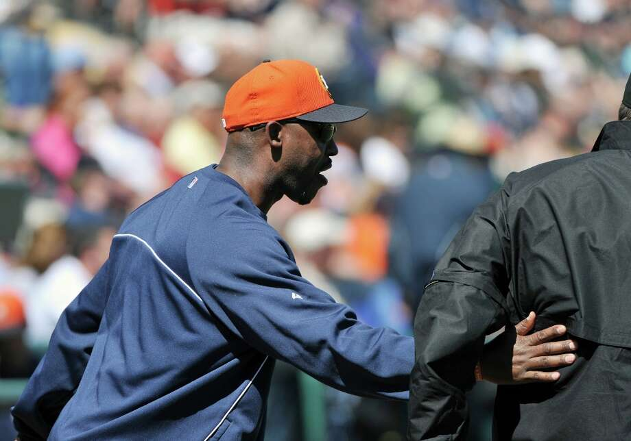 Manager Bo Porter greets home plate umpire Jeff Gosney before the game. Photo: Al Messerschmidt / 2013 Getty Images