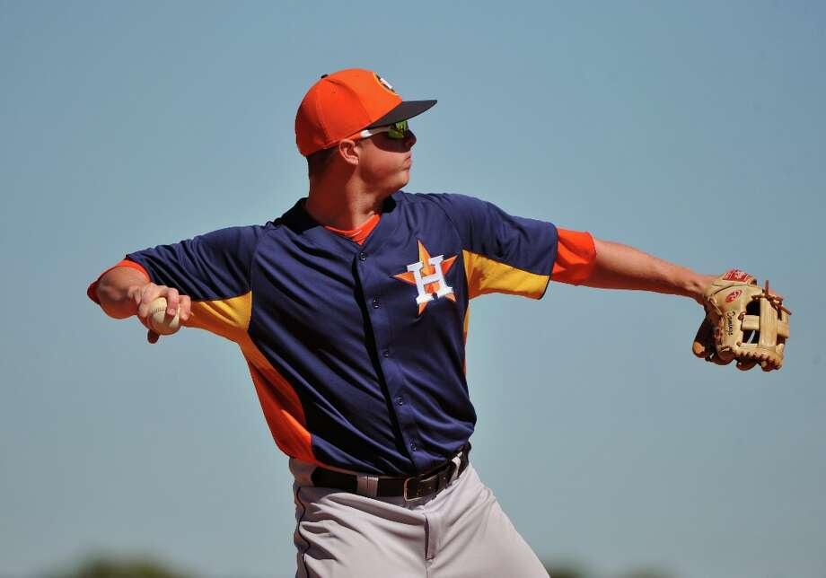 Infielder Matt Dominguez throws to first base. Photo: Al Messerschmidt / 2013 Getty Images