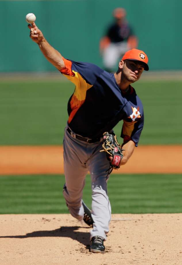 Astros pitcher Jarred Cosart throws against the Tigers during the first inning. Photo: David J. Phillip
