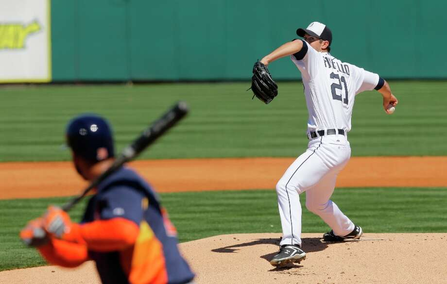 Tigers pitcher Rick Porcello throws to Fernando Martinez, left, during the first inning. Photo: David J. Phillip