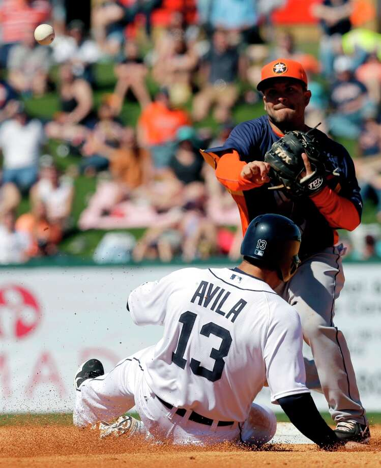 Astros second baseman Jose Altuve, right, throws to first to complete a double play as Alex Avila slides into second during the third inning. Avila was out at second and Jhonny Peralta was out at first on the double play. Photo: David J. Phillip