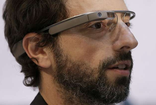 Google co-founder Sergey Brin demonstrates Google Glass, which puts familiar smartphone functions into the wearer's peripheral vision. Photo: Jeff Chiu, Associated Press