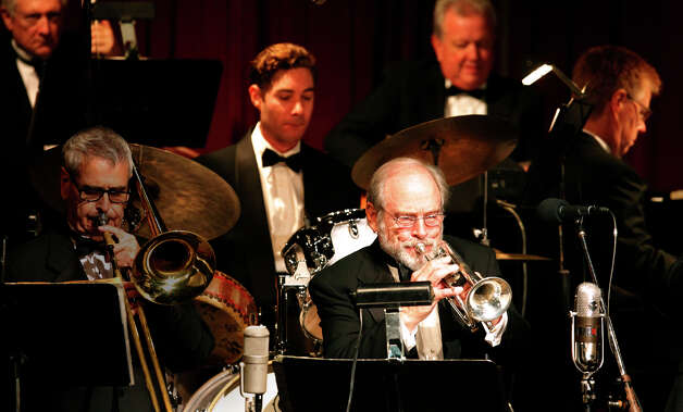 "Local jazz great Jim Cullum, playing his familiar brass cornet, joins the rest of his group, The Jim Cullum Jazz Band, in a performance at the Pearl Stable to celebrate their 20th anniversary of their public radio program ""Riverwalk Jazz"" on Oct. 7, 2009. They were playing in front of an audience during a taping for the show.  Photo: KIN MAN HUI, San Antonio Express-News / kmhui@express-news.net"