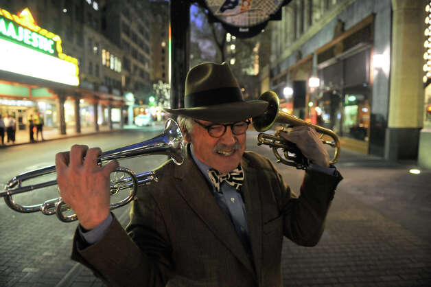 "San Antonio musician Jim Cullum  jokes around along Houston St. prior to a weeknight gig at Bohanan's recently. Archive's from Cullem's long-running NPR show, ""Live from the Landing"", are now being streamed 24/7 by Stanford University. Photo: Robin Jerstad"