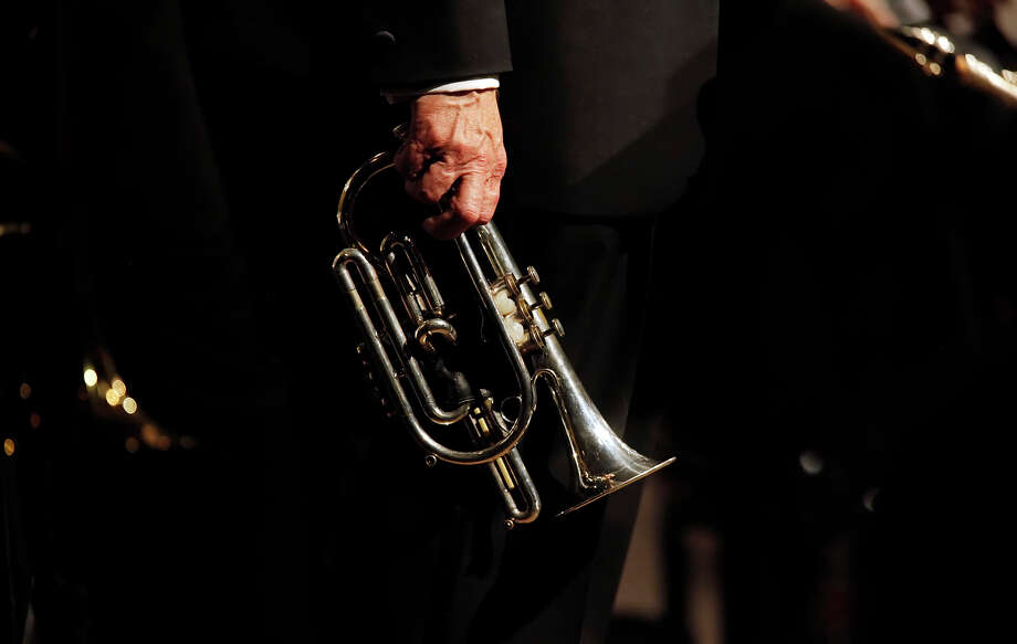 "Local jazz great Jim Cullum holds his familiar brass cornet as he joins the rest of his group, The Jim Cullum Jazz Band, in a performance at the Pearl Stable to celebrate their 20th anniversary of their public radio program ""Riverwalk Jazz"" on Oct. 7, 2009. They were playing in front of an audience during a taping for the show.  Photo: KIN MAN HUI, San Antonio Express-News / kmhui@express-news.net"