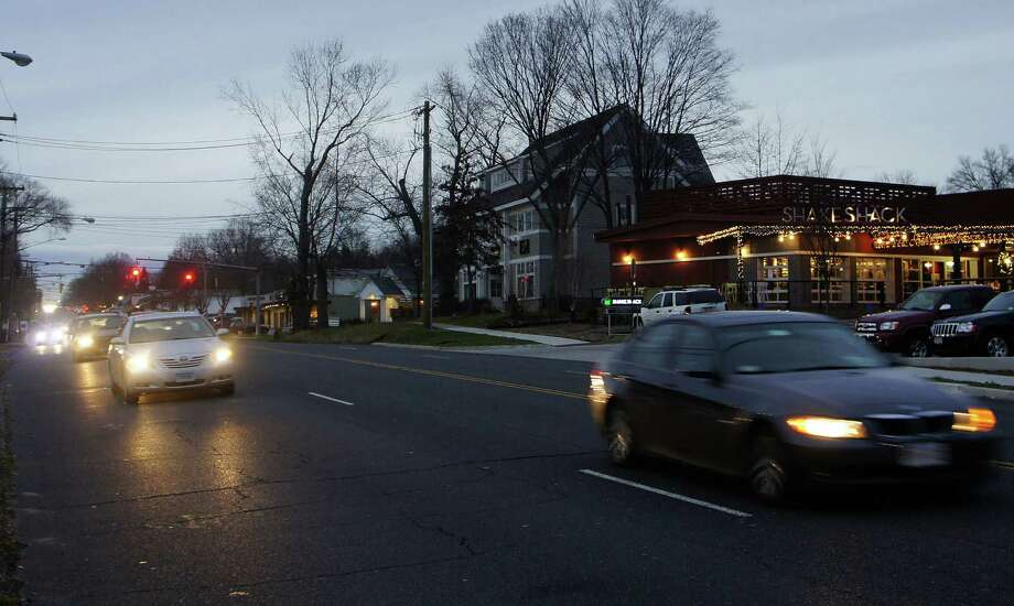 Cars head east on busy Post Road East in Westport, in front of the Shake Shack restaurant not far from the Fairfield border, where a Fairfield man was struck and killed while trying to cross the road Saturday evening. Photo: File Photo / Westport News