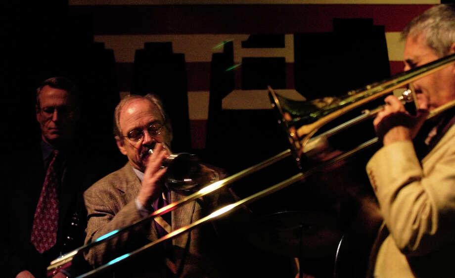 Jim Cullum and his band perform April 30, 2004, at The Landing. Photo: BAHRAM MARK SOBHANI, SAN ANTONIO EXPRESS-NEWS / SAN ANTONIO EXPRESS-NEWS