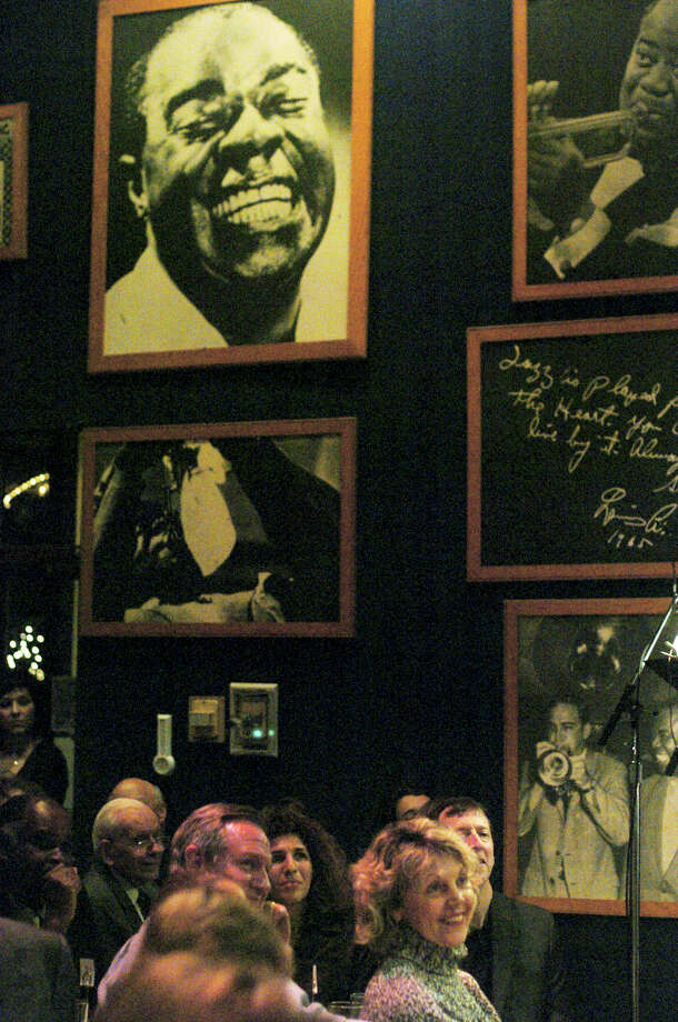 A portrait of Louis Armstrong smiles upon guests at Jim Cullum's Landing during a night of jazz on the River Walk Dec. 14, 2005. Photo: BILLY CALZADA, SAN ANTONIO EXPRESS-NEWS / SAN ANTONIO EXPRESS-NEWS