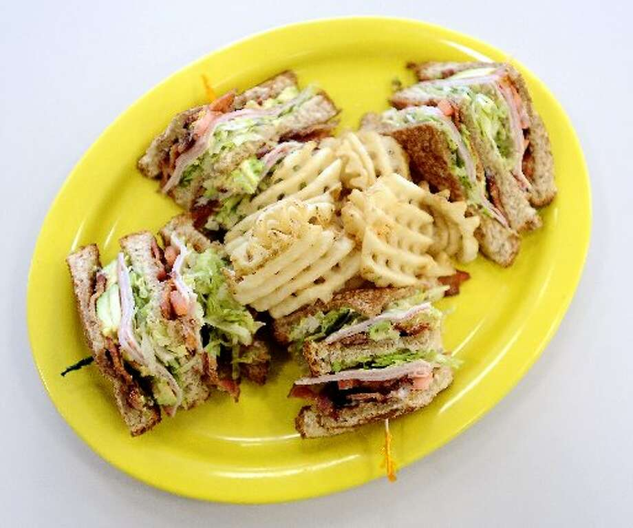 The Triple Decker served with waffle fries. Randy Edwards/cat5