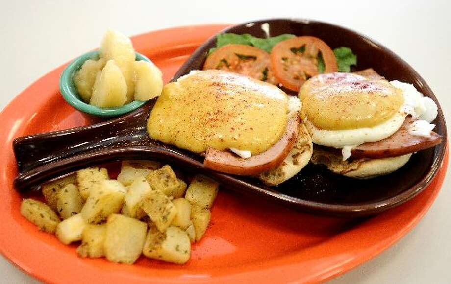 Eggs Benedict served with Peasant Potatoes and an English Muffin. Randy Edwards/cat5