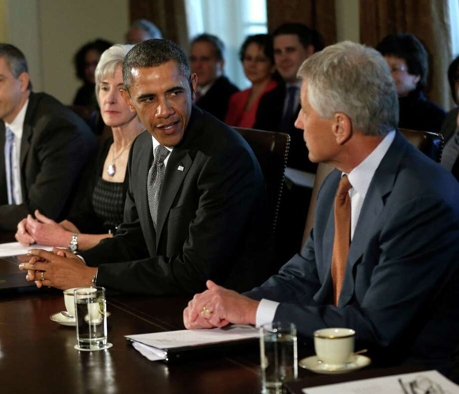 President Barack Obama welcomes his new Defense Secretary Chuck Hagel, right, as he speaks to members of the media at the start of a cabinet meeting in the Cabinet Room of the White House in Washington, Monday, March 4, 2013. From left are, Education Secretary Arne Duncan, Health and Human Services Secretary Kathleen Sebelius, Obama and Hagel. (AP Photo/Pablo Martinez Monsivais) Photo: Pablo Martinez Monsivais