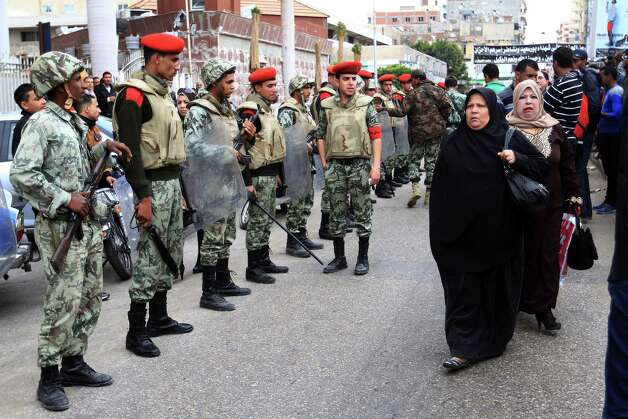 Egyptian army soldiers and military police secure a funeral procession for civilians killed overnight during street battles with police forces, in Port Said, Egypt, Monday, March 4, 2013. The fighting on Sunday prompted the military to intervene to break up the clashes, the first such intervention by the army since the military was deployed in Port Said in late January when tension between protesters and police first erupted. (AP Photo/Ahmed Ramadan) Photo: Ahmed Ramadan