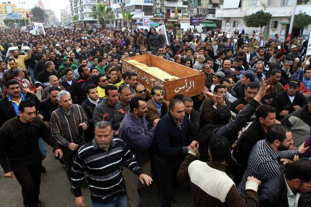 Thousands of residents join a funeral procession for civilians, killed overnight during street battles with security forces, in Port Said, Egypt, Monday, March 4, 2013. The fighting on Sunday prompted the military to intervene to break up the clashes, the first such intervention by the army since the military was deployed in Port Said in late January when tension between protesters and police first erupted. (AP Photo/Ahmed Ramadan) Photo: Ahmed Ramadan