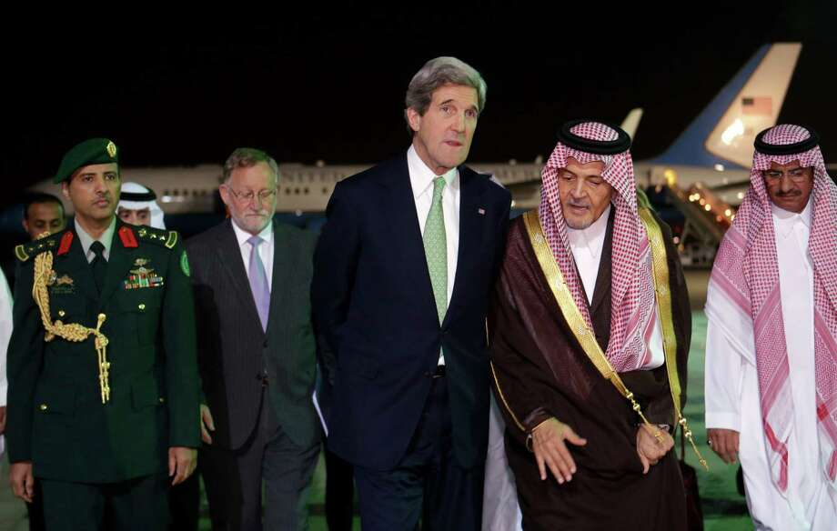 U.S. Secretary of State John Kerry, center, walks with Saudi Foreign Minister Prince Saud al-Faisal, as Kerry arrives in Riyadh, Saudi Arabia on Sunday, March 3, 2013. Saudi Arabia is the seventh leg of Kerry's first official overseas trip. (AP Photo/Jacquelyn Martin, Pool) Photo: Jacquelyn Martin