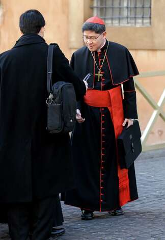 Cardinal Luis Antonio Tagle, of the Philippines, right, arrives for a meeting, at the Vatican, Monday, March 4, 2013. Cardinals from around the world have gathered inside the Vatican for their first round of meetings before the conclave to elect the next pope, amid scandals inside and out of the Vatican and the continued reverberations of Benedict XVI's decision to retire. (AP Photo/Andrew Medichini) Photo: Andrew Medichini
