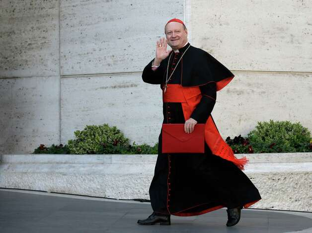 Italian Cardinal Gianfranco Ravasi waves to reporters as he arrives for a meeting, at the Vatican, Monday, March 4, 2013. Cardinals from around the world have gathered inside the Vatican for their first round of meetings before the conclave to elect the next pope, amid scandals inside and out of the Vatican and the continued reverberations of Benedict XVI's decision to retire. (AP Photo/Andrew Medichini) Photo: Andrew Medichini