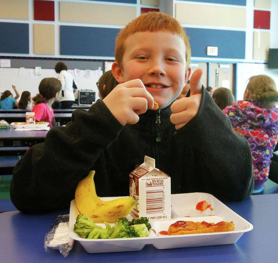 A new federal report found that school children are consuming fewer calories, but not all calories are create equal and junk food remains pervasive. Photo: John Hickey, Associated Press / The Buffalo News