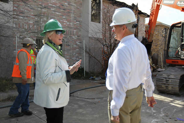 Bexar County District Attorney Susan Reed talks with Pct. 4 County Commissioner Tommy Adkisson at the start of the demolition of two multi-family structures on Windsor Oaks in east Bexar County, Monday, March 4, 2013. Photo: Jerry Lara, San Antonio Express-News / © 2013 San Antonio Express-News