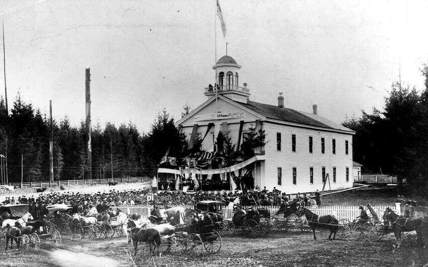This photo was taken Nov. 18, 1889. It shows what was then the state capitol with flags and banners for the delayed inauguration of Elisha P. Ferry, the state's first governor. Washington had become the 42nd state the week before, but the new government couldn't take over until a technicality had been cleared.