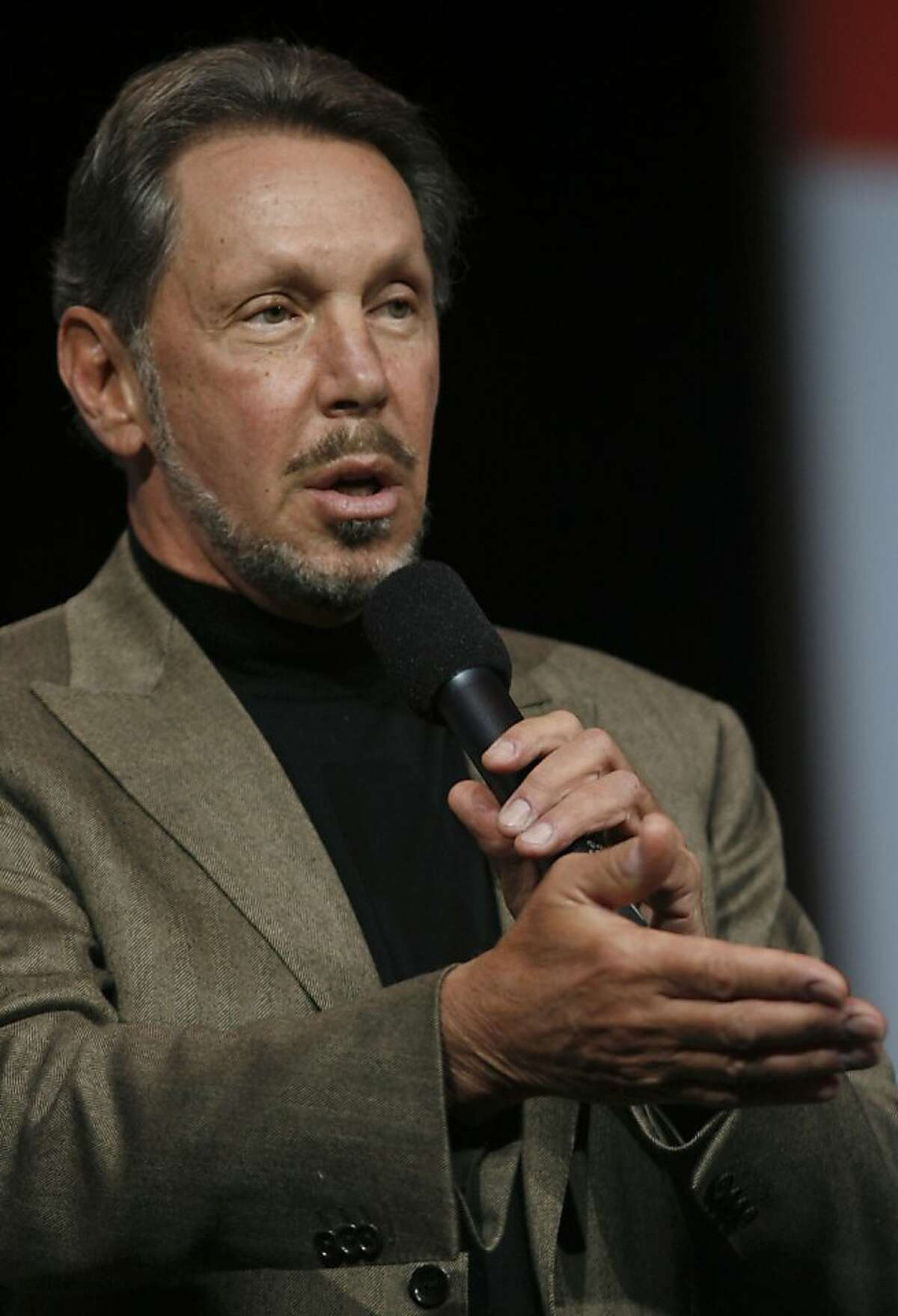 """Larry Ellison is stepping down as CEO for Oracle.Oracle CEO Larry Ellison delivers a keynote at the Moscone Center in San Francisco during the Oracle OpenWorld 2011 in this October 5, 2011 file photo in California. Ellison, who bought his own Hawaiian island last year, now has an airline to go with it. Island Air, a regional carrier based in the Pacific island state, announced February 27, 2013 that it had closed its sale to a newly formed holding company owned by Ellison, co-founder and chief executive of business software firm Oracle. """"This is another major investment and commitment to Hawaii,"""" said a statement by Paul Marinelli, vice president of Lawrence Investments, LLC, the Ellison-owned holding company."""