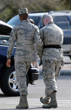 Staff Sgt. Ryan Deraas of the 326th Training Squadron is led away after his conviction at Lackland Air Force Base, Monday, March 4, 2013. Deraas pled guilty to various charges including unprofessional relationships with five technical training students. He was handed a three-month sentence, dishonorably discharged and a reduction in rank. Photo: Jerry Lara, San Antonio Express-News / © 2013 San Antonio Express-News
