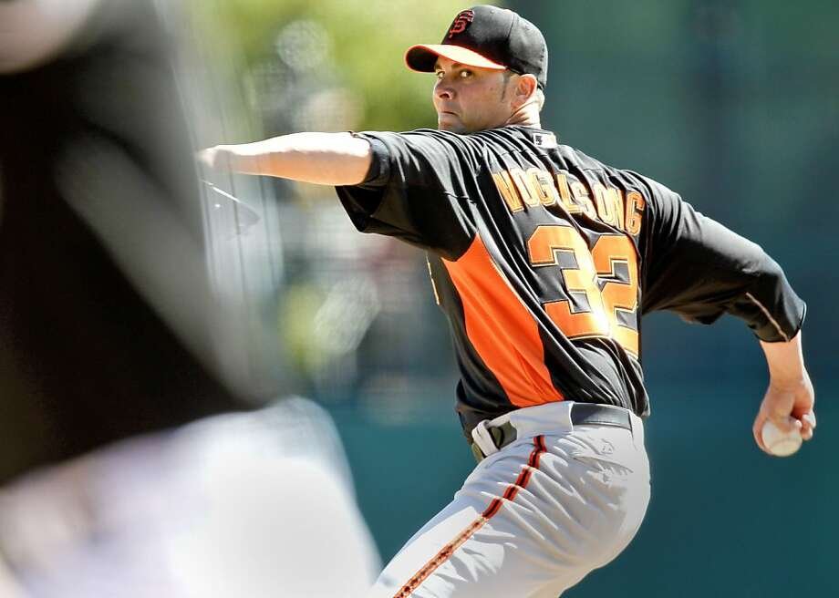 Giants' starting pitcher Ryan Vogelsong throws in the first inning, as the San Francisco Giants went on to fall to the Chicago White Sox 6-2 in spring training baseball at Camelback Ranch on Monday Mar. 4, 2013, In Glendale, Az. Photo: Michael Macor, The Chronicle