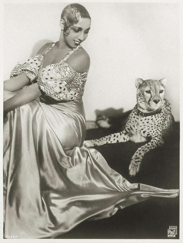 Portrait of American cabaret entertainer Josephine Baker as she sits with her pet cheetah, Chiquita, in the early 1930s. Photo: Transcendental Graphics, Getty Images