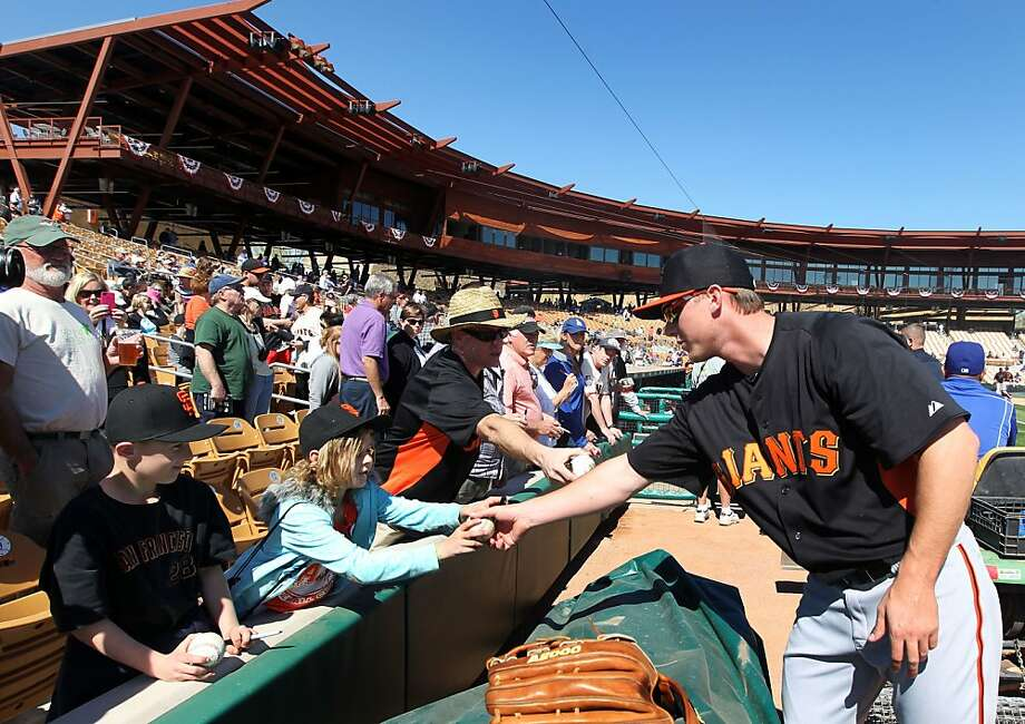 San Francisco Giants Gary Brown signs autographs prior to the start of their exhibition spring training baseball game with the Los Angeles Dodgers Tuesday, Feb. 25, 2013, in Phoenix, Ariz. Photo: Lance Iversen, The Chronicle