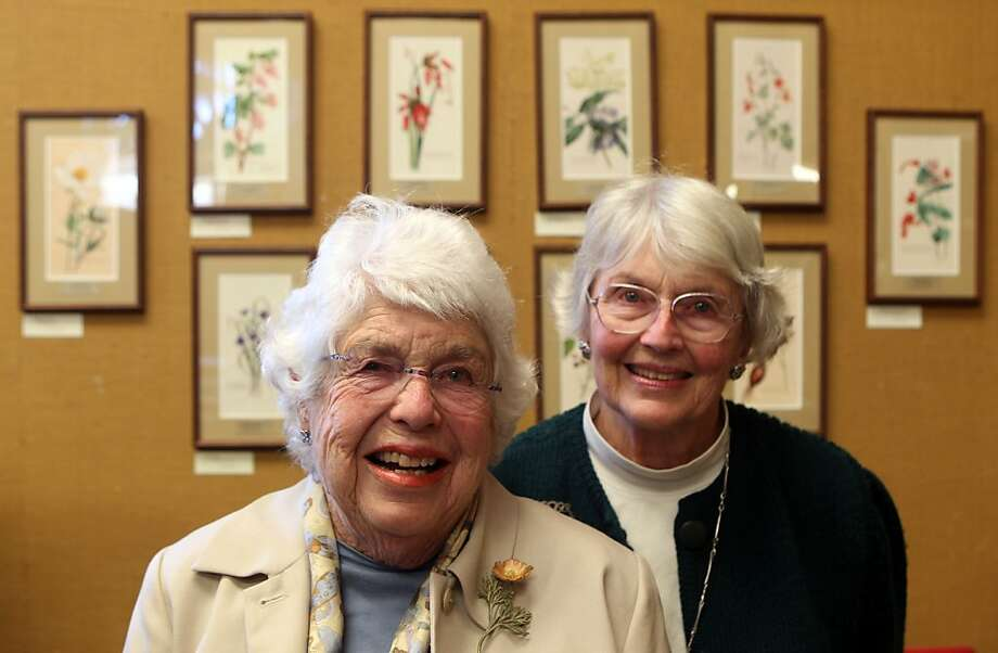 "Nancy Donnelly Praetzel (left) and her sister Eugenia ""Genie"" Donnelly Herr with wildflower prints painted by their grandfather, Ernest Clayton. Photo: Lance Iversen, The Chronicle"