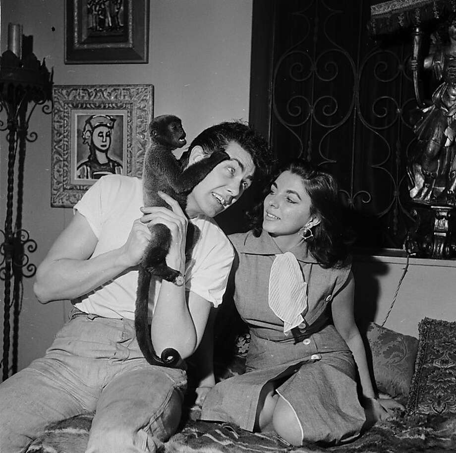 British starlet Joan Collins with her husband Maxwell Reed and their pet monkey Spider at their Spanish-themed home in London's Mayfair.  Photo: John Pratt, Keystone Features/Getty Images