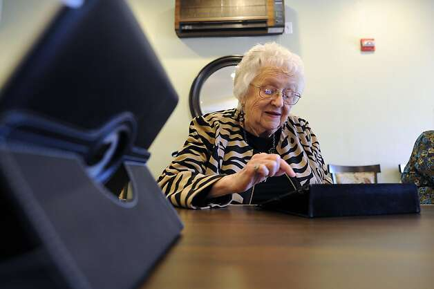 Ruth Hutton, 90, likes watching YouTube and playing Mahjong  on her iPad at the Sunny View Retirement Center in Cupertino.  The Center offers an iPad training class and lends out iPads to its residents in the hopes they will stay connected with family and friends and use the technology to stay mentally sharp. Photo: Michael Short, Special To The Chronicle