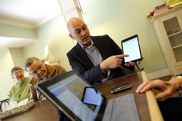 Bill Penrod demonstrates an iPad to Ron and Pat Hassett at the Sunny View Retirement Community in Cupertino. Photo: Michael Short, Special To The Chronicle