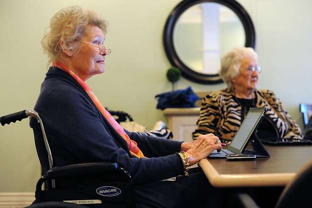 "Jane Winby (left) and Ruth Hutton use iPads at Cupertino's Sunny View Retirement Community. ""You gotta keep thinking, or you might get dull,"" Hutton says. Photo: Michael Short, Special To The Chronicle"