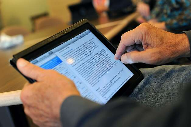 Former IBM employee Bob Brenner, 75, uses his iPad for communicating with his family and keeping up with the news. Photo: Michael Short, Special To The Chronicle