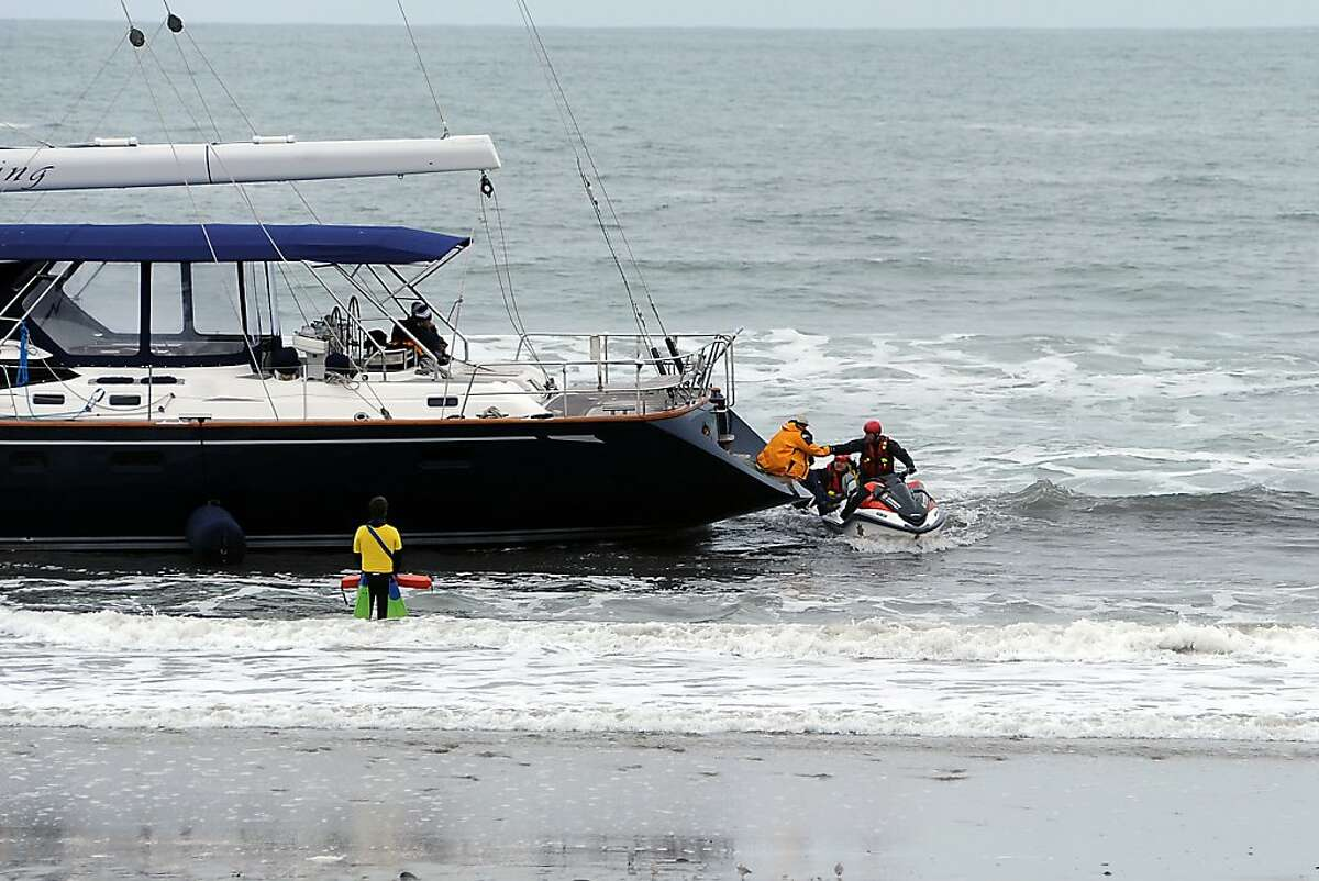 The first male suspect is rescued from the stranded yacht. An 82 foot sailboat stolen from the Sausalito Yacht Harbor ran aground with suspects still aboard at Linda Mar Beach in Pacifica, CA Monday March 4th, 2013.