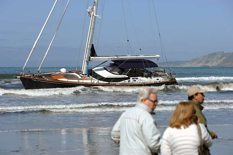The yacht Darling sits stuck at Linda Mar Beach after being stolen. Photo: Michael Short, Special To The Chronicle