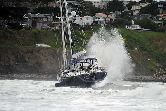 Waves batter the yacht as it sits in the surf at Linda Mar Beach.  An 82 foot sailboat stolen from the Sausalito Yacht Harbor is run aground with suspects  still aboard at Linda Mar Beach in Pacifica, CA Monday March 4th, 2013. Photo: Michael Short, Special To The Chronicle