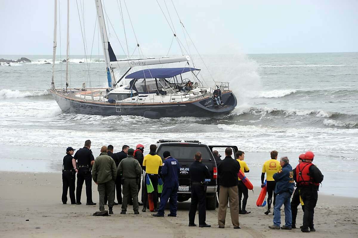 Local and state police gather on the beach as they negotiate with 3 suspects that onboard a stolen yacht. An 82 foot sailboat stolen from the Sausalito Yacht Harbor ran aground at Linda Mar Beach in Pacifica, CA Monday March 4th, 2013.