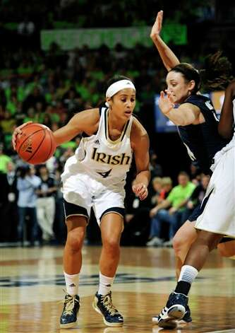 Notre Dame guard Skylar Diggins, left, drives the lane as Connecticut guard Kelly Faris defends during the first half of an NCAA college basketball game, Monday, March 4, 2013, in South Bend, Ind. (AP Photo/Joe Raymond)