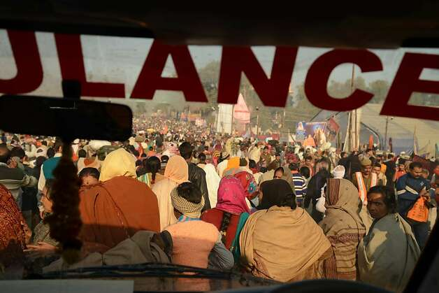 An ambulance negotiates crowds of pilgrims at the Maha Kumbh Mela festival. Public health experts are studying the huge gathering. Photo: Dhruv S. Kazi