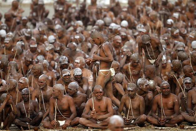 Hindu holy men take part in a ritual to rid themselves of all material ties. The ceremony can only be done at the Kumbh festival, which will draw more than 80 million Hindu pilgrims. Photo: Rajesh Kumar Singh, Associated Press