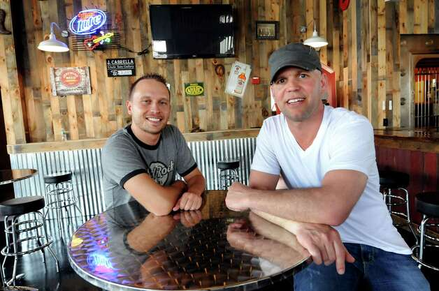 Business partners Alessio Depoli, left, and Chris Pratt sit in their new bar called Barrel Saloon, Rock and Roll Country Bar, on Tuesday, May 24, 2011, in Albany, N.Y. (Cindy Schultz / Times Union) Photo: Cindy Schultz