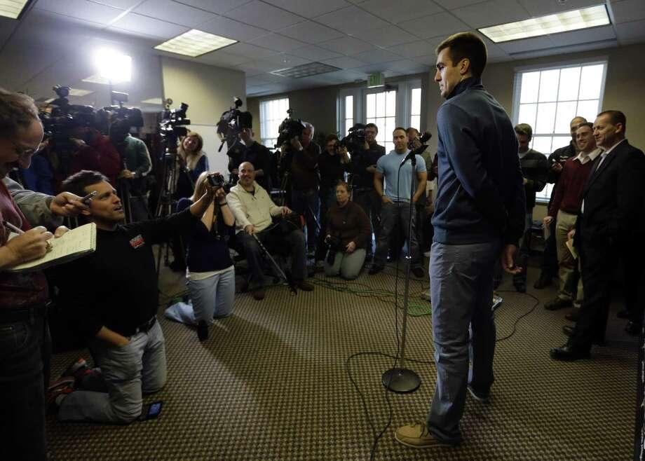 Ravens quarterback Joe Flacco, speaking to reporters, will receive a $29 million signing bonus. Photo: Patrick Semansky / Associated Press